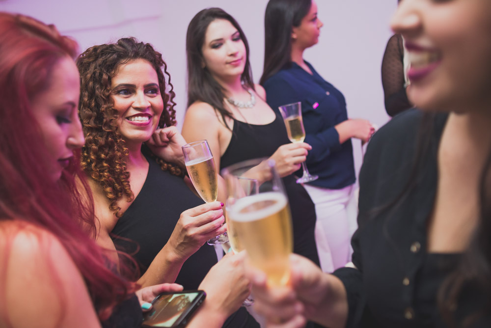 Image of women drinking and having a good time at a corporate event for their copmany