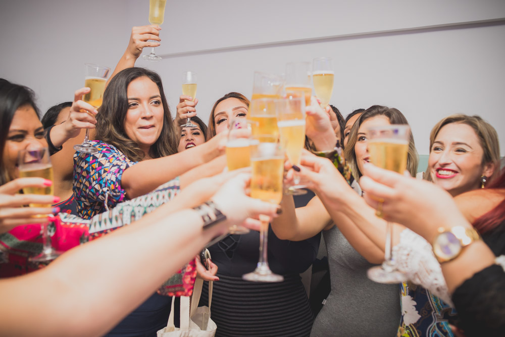 Picture of women toasting at an event for their company