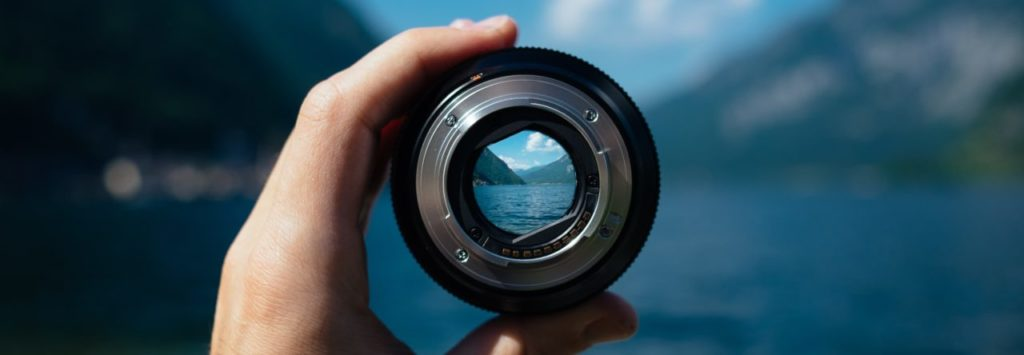 Looking through a lens at a landscape on the site ComposeClick.com