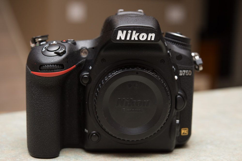 picture of the Nikon d750 from the front with the body cap on