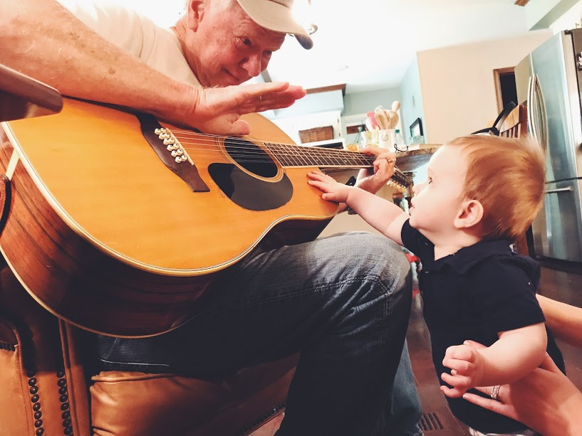 Image of grandpa playing guitar for grandson shot with the iPhone 7 Plus camera