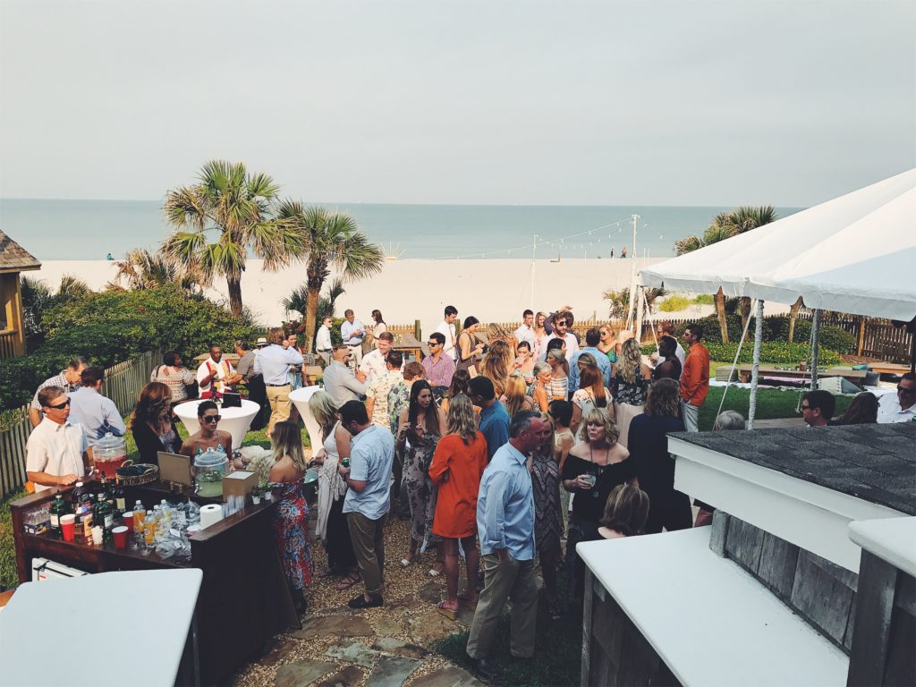 iPhone 7 Plus image of people gathered for a wedding on a beach