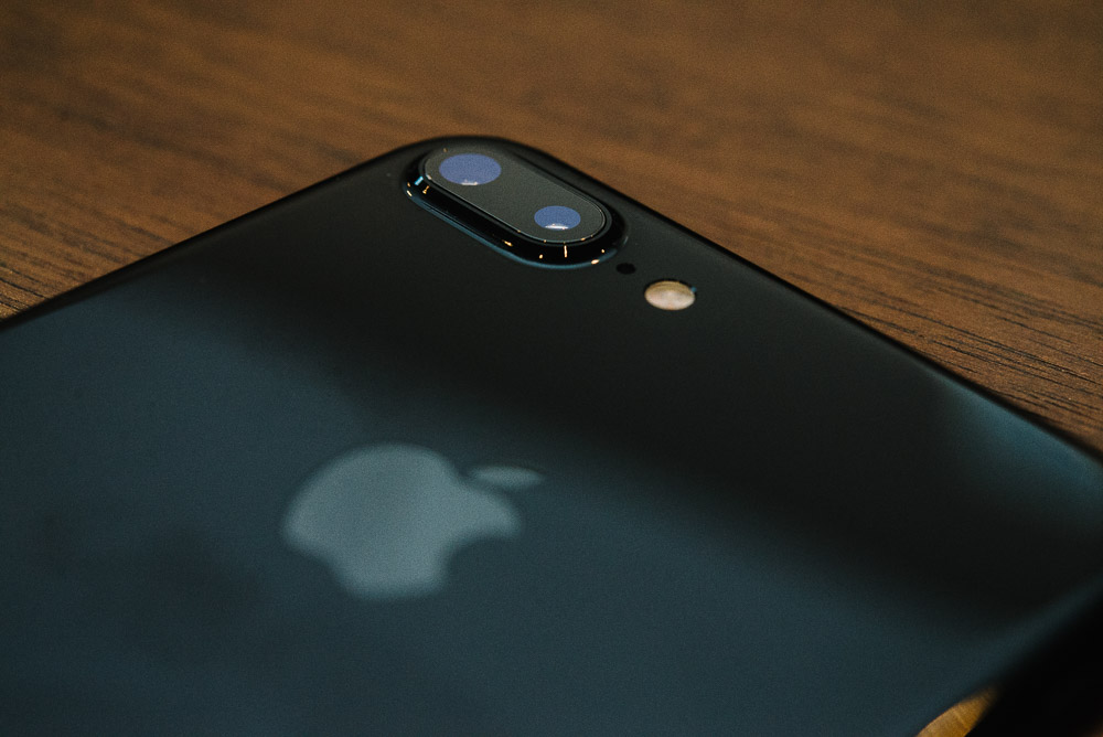 Image of the iPhone 7 Plus on a wooden table taken with flash