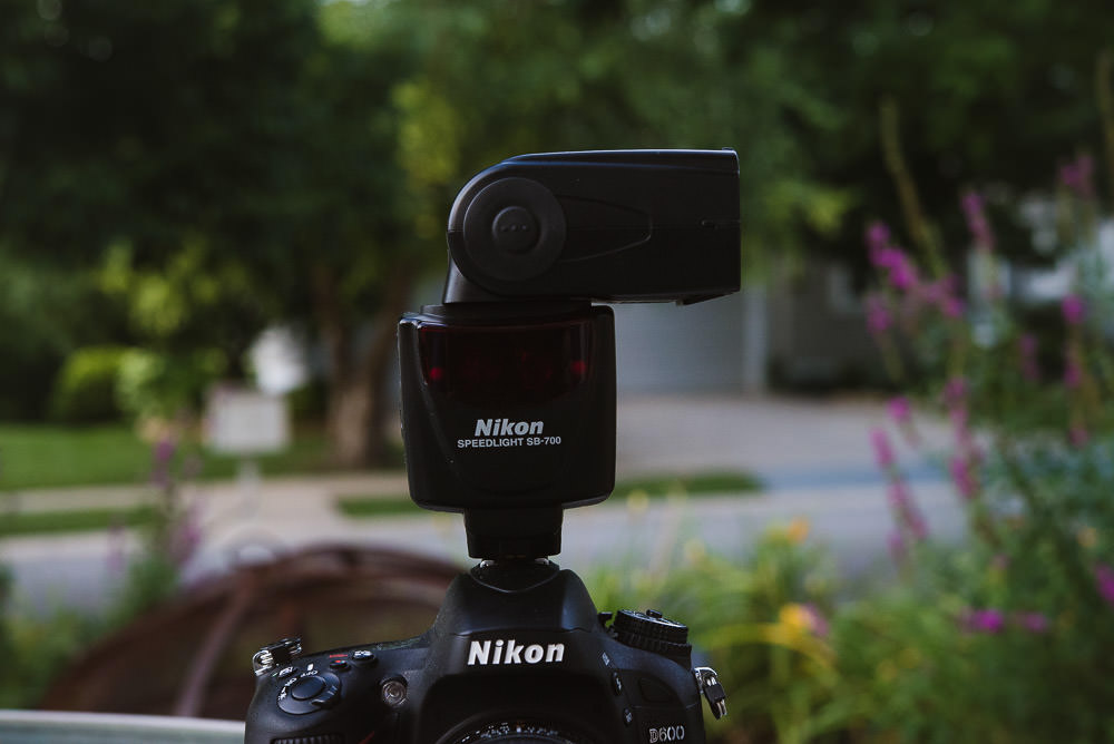 Photo of the Nikon SB 700 flash pointed to the side for bouncing off a wall