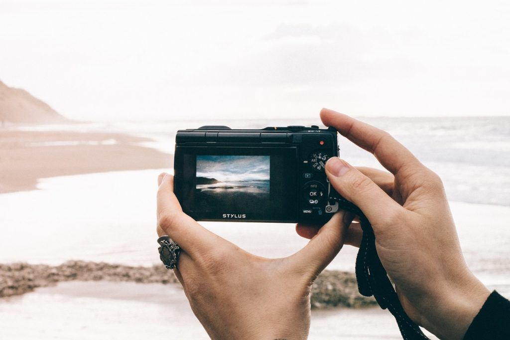 Image showing a photographer using their camera from the LCD screen