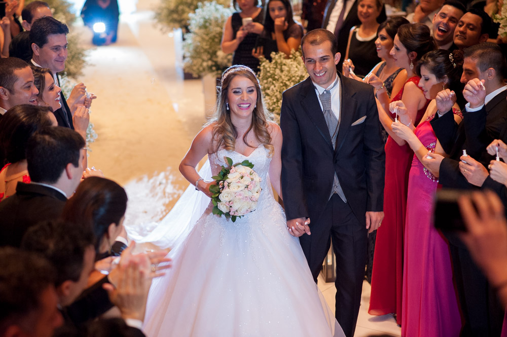 Wedding photography image of couple leaving their ceremony from an angle