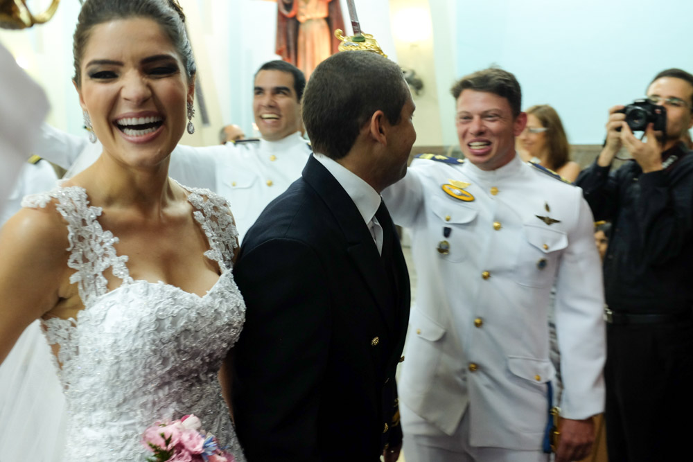 Image of a bride and groom smiling and laughing as they exit their wedding ceremony