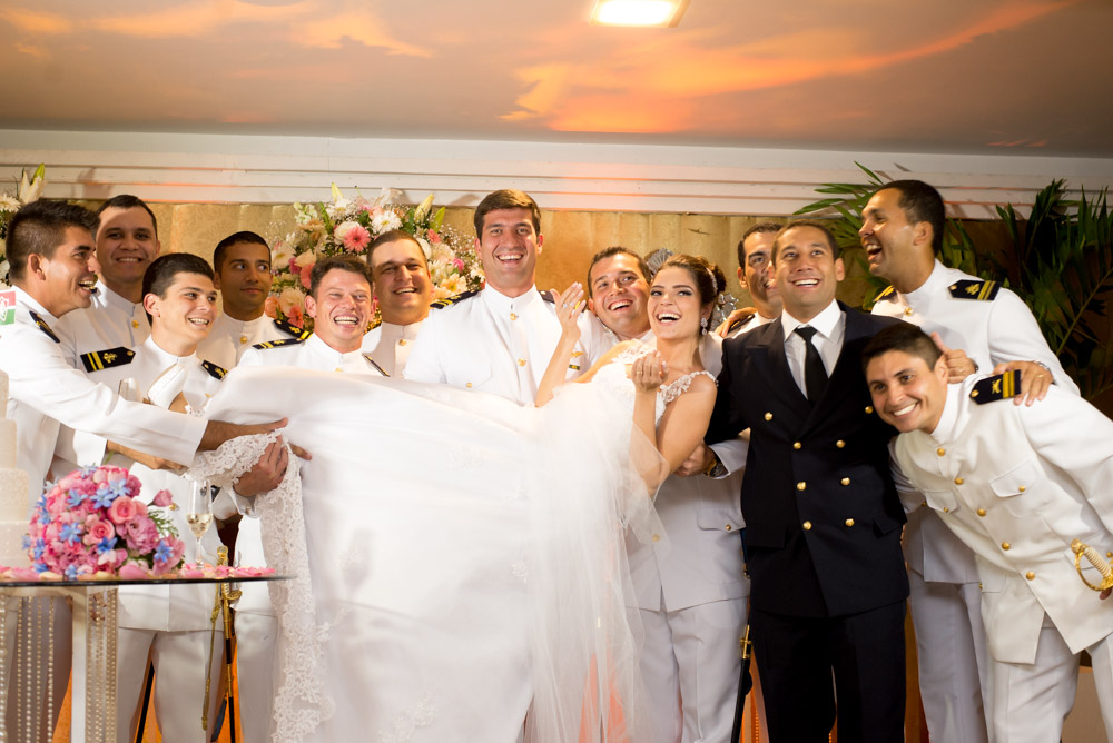 Picture of groomsmen at a brazilian wedding holding up bride