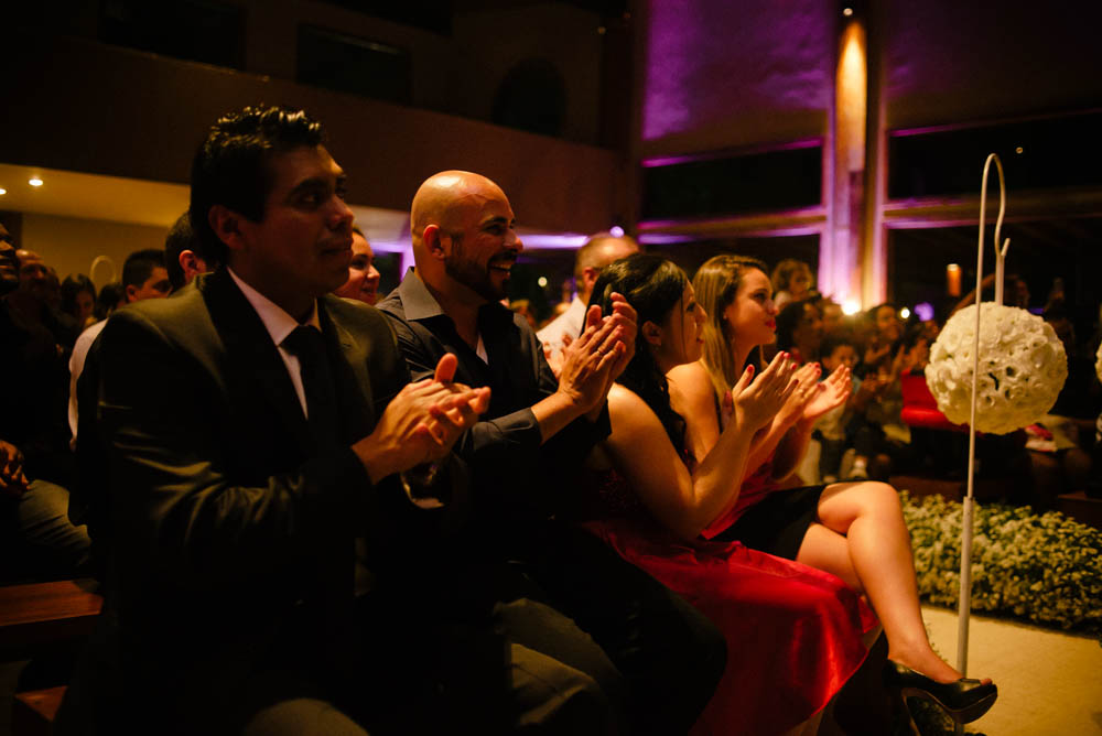 Image of a groom's best friend applauding during wedding ceremony