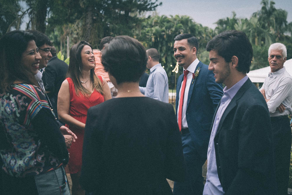 Image of a groom laughing and socializing before his wedding ceremony