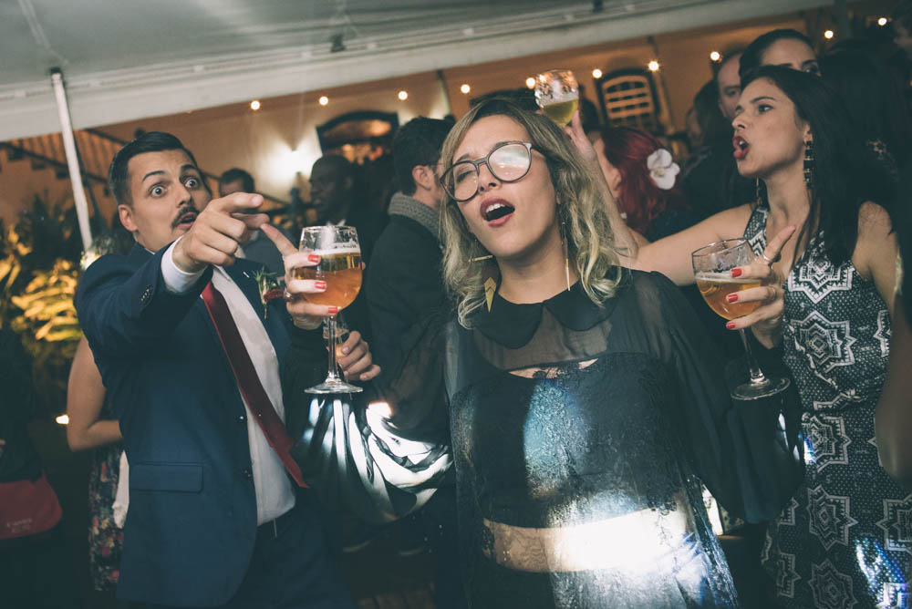 Image of wedding reception party with people drinking beer and singing and dancing