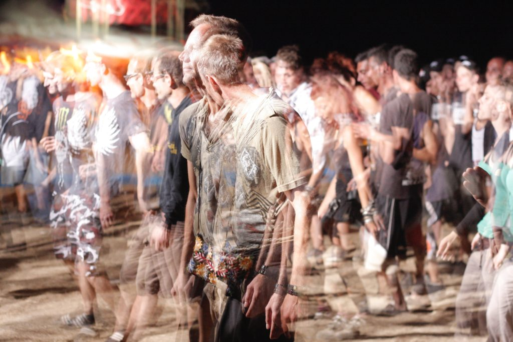 Image of party-goers out of focus
