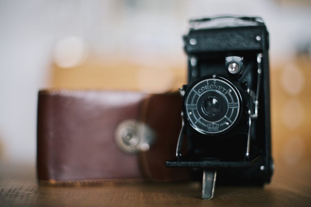 image showing old camera and case for post about photography categories list
