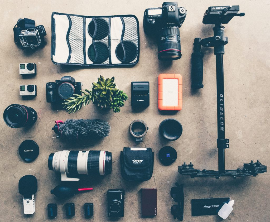 image showing a bunch of camera equipment to show what does a wedding photography assistant do