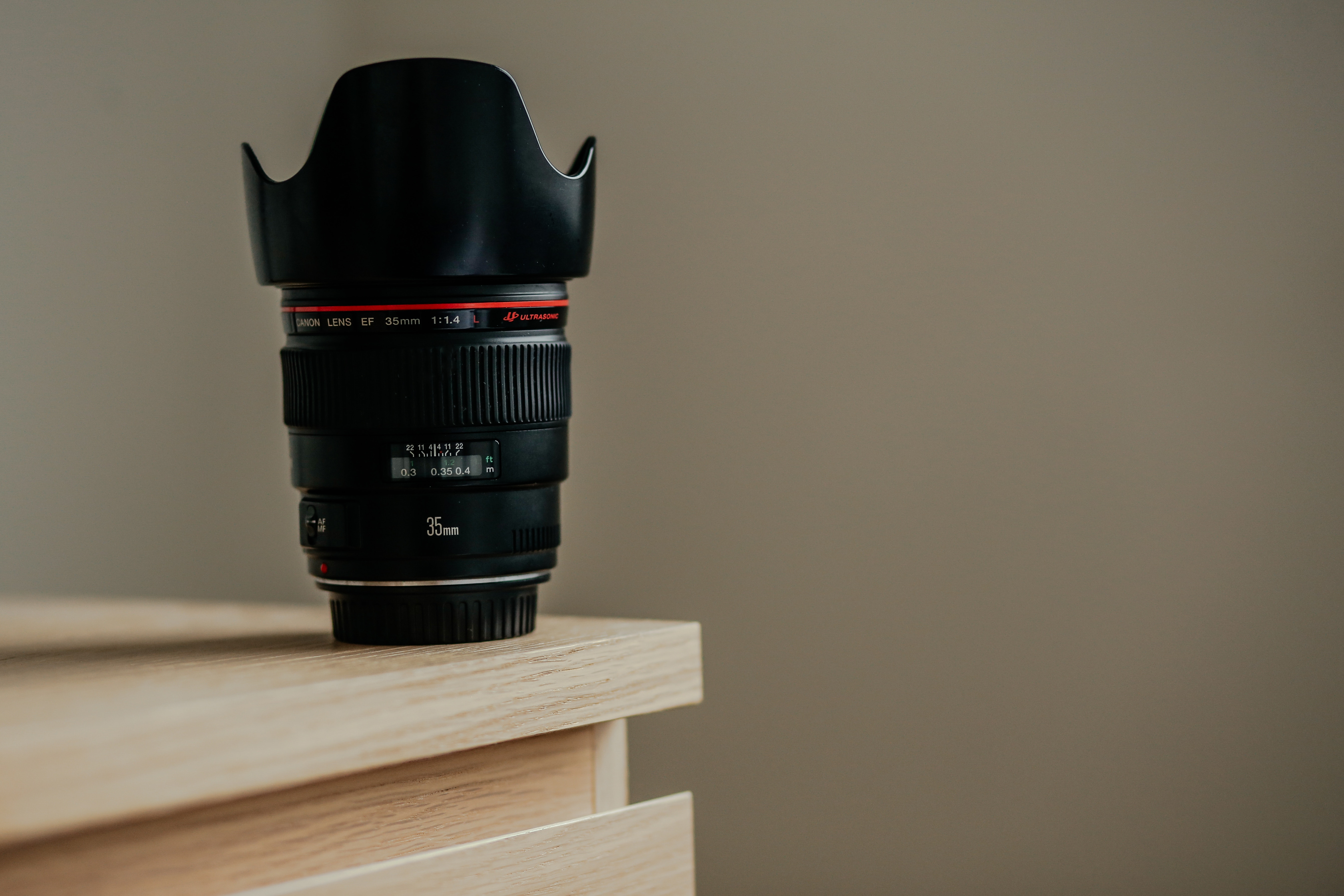 image of a canon lens with a petal lens hood for blog post about the purpose of camera lens hoods
