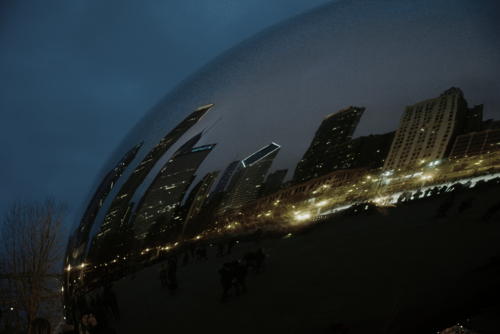 Image of the Chicago Bean dark at night with ominous reflections of buildings