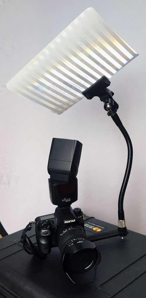 A do-it-yourself setup of a flash shooting into a makeshift wall so that you can get softer light for corporate portraits
