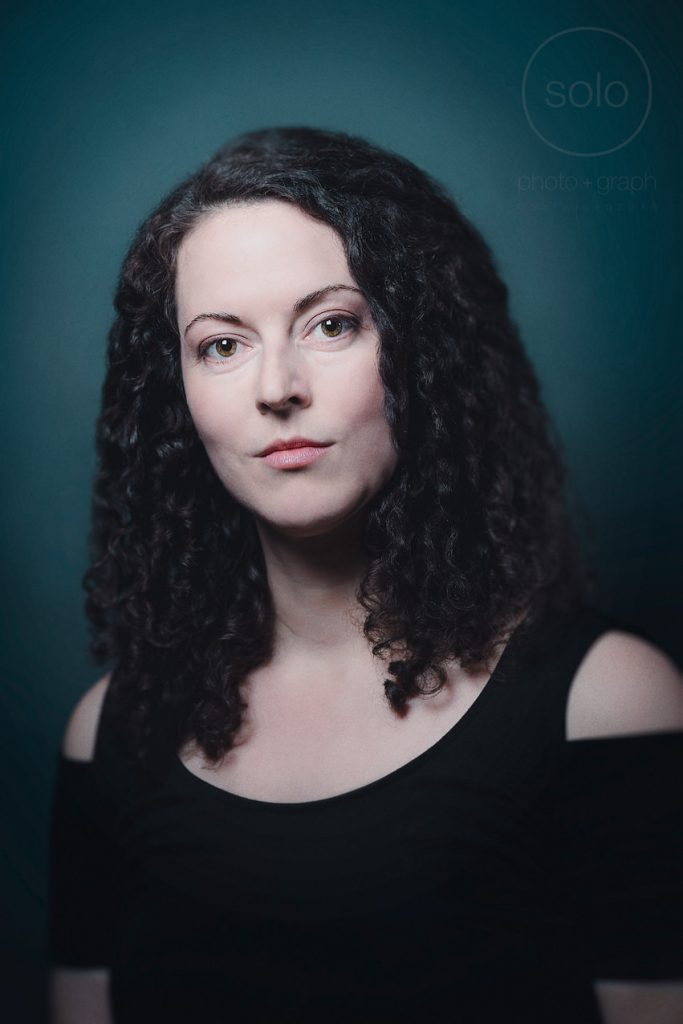 Example of a creative portrait of an actress with dark curly hair