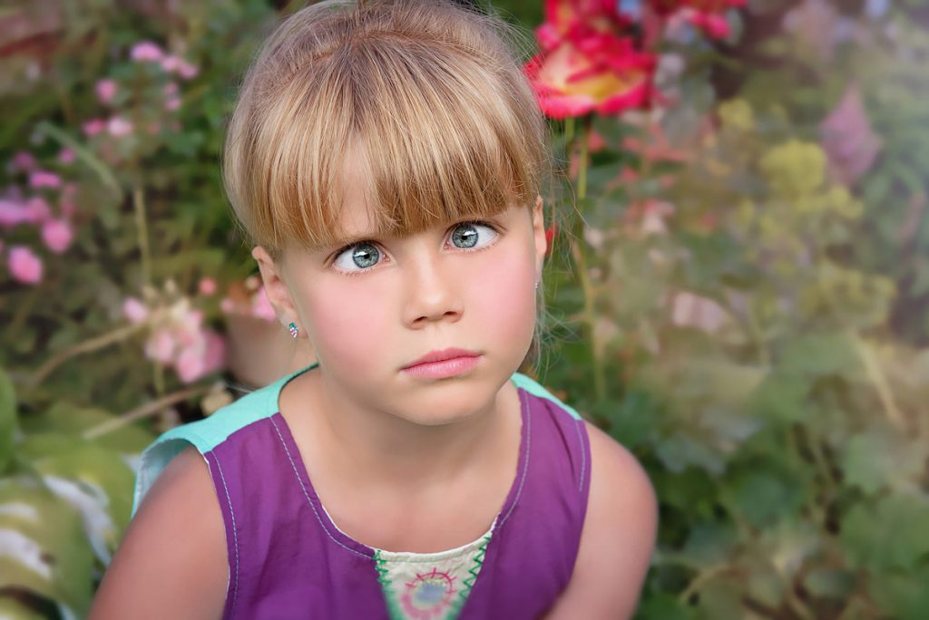 Image of a girl with a look of confusion on her face