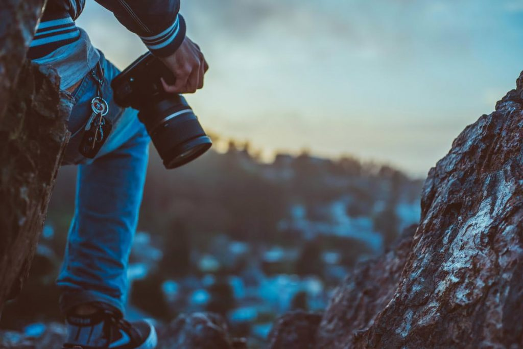 Image of a nature photographer looking for the next shot