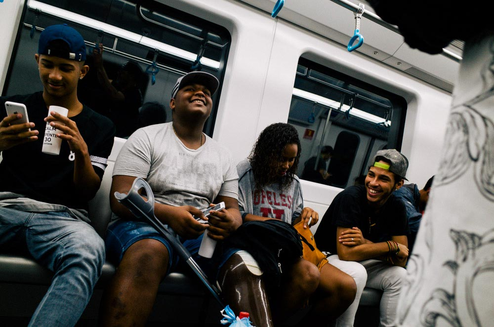 Street photography image shot on a subway with a 28mm lens
