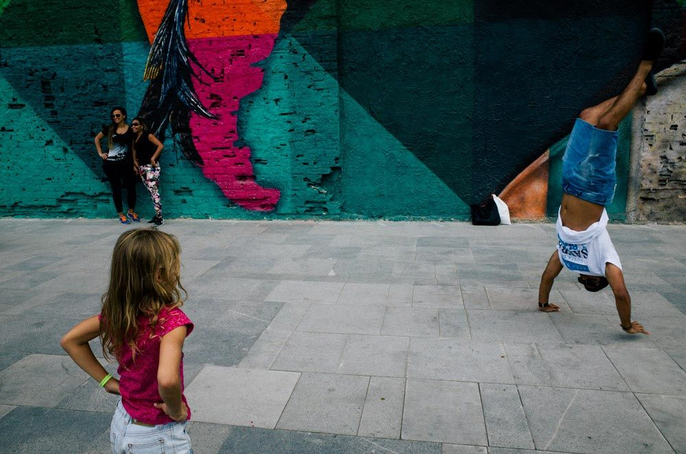 Street photography image of people in front of a map mural