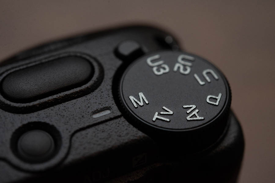 Image of a mode dial of a compact street photography camera