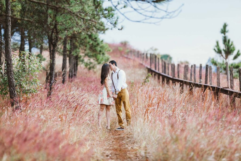 Image of a couple right after they got engaged on a trail surrounded by nature