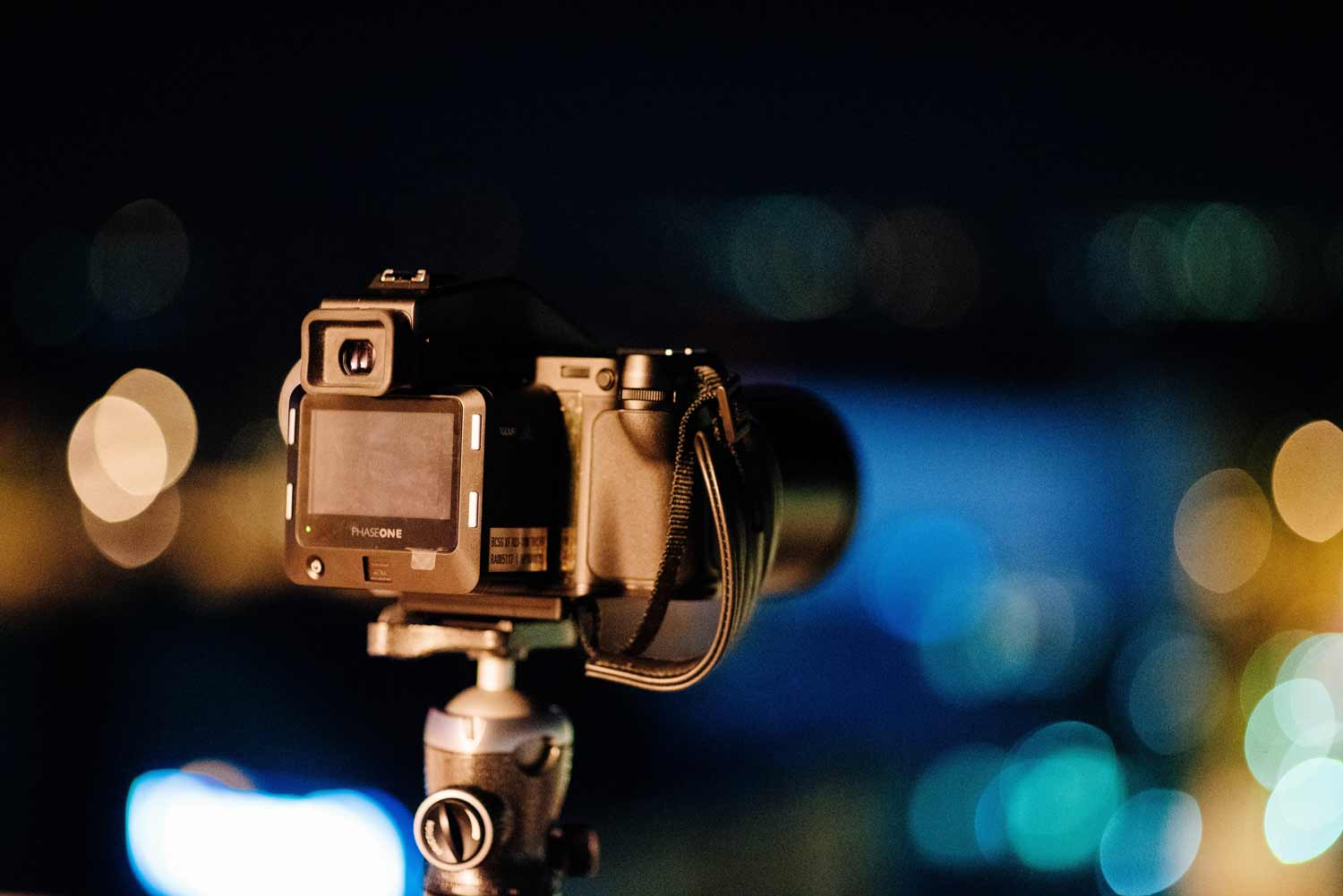 Image of a camera set up on a tripod for event photography