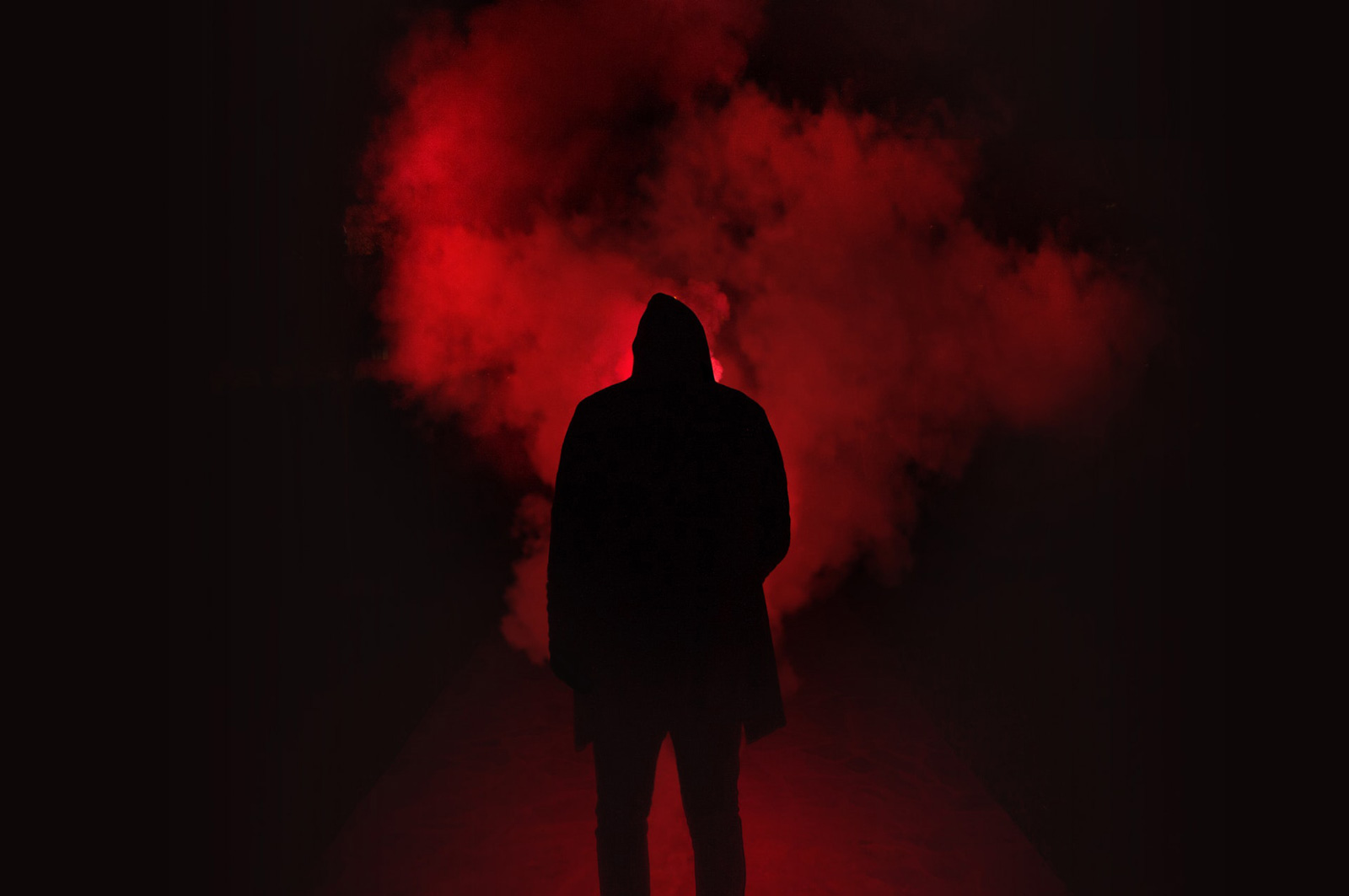 Image of a man's silhouette in a red dark scene