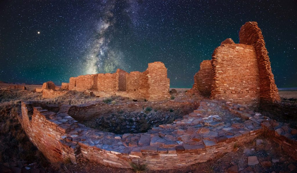 Image of ruins with the night sky and milky way in the background