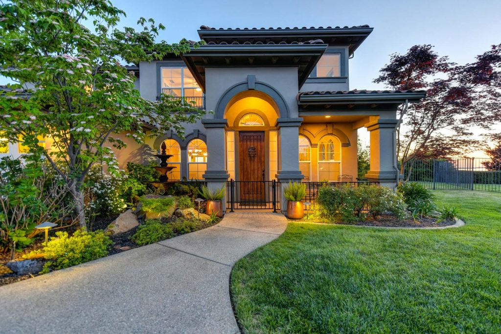 Real estate photo of a modern house on the market in the evening as the sun is going down
