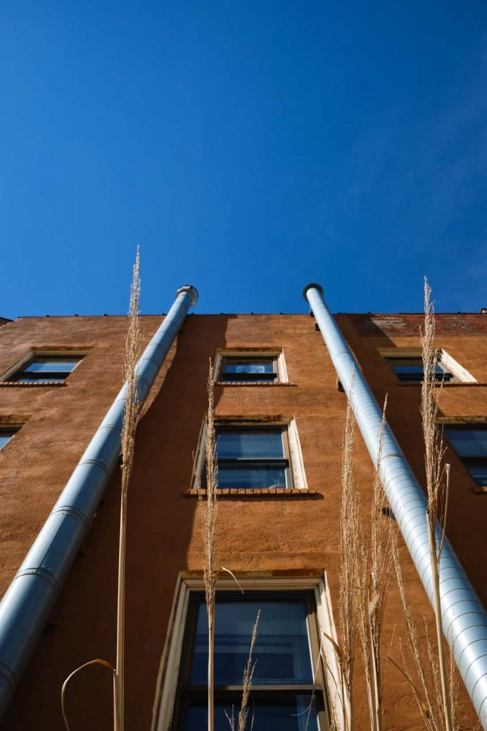 Vertical image of brown building and deep blue sky
