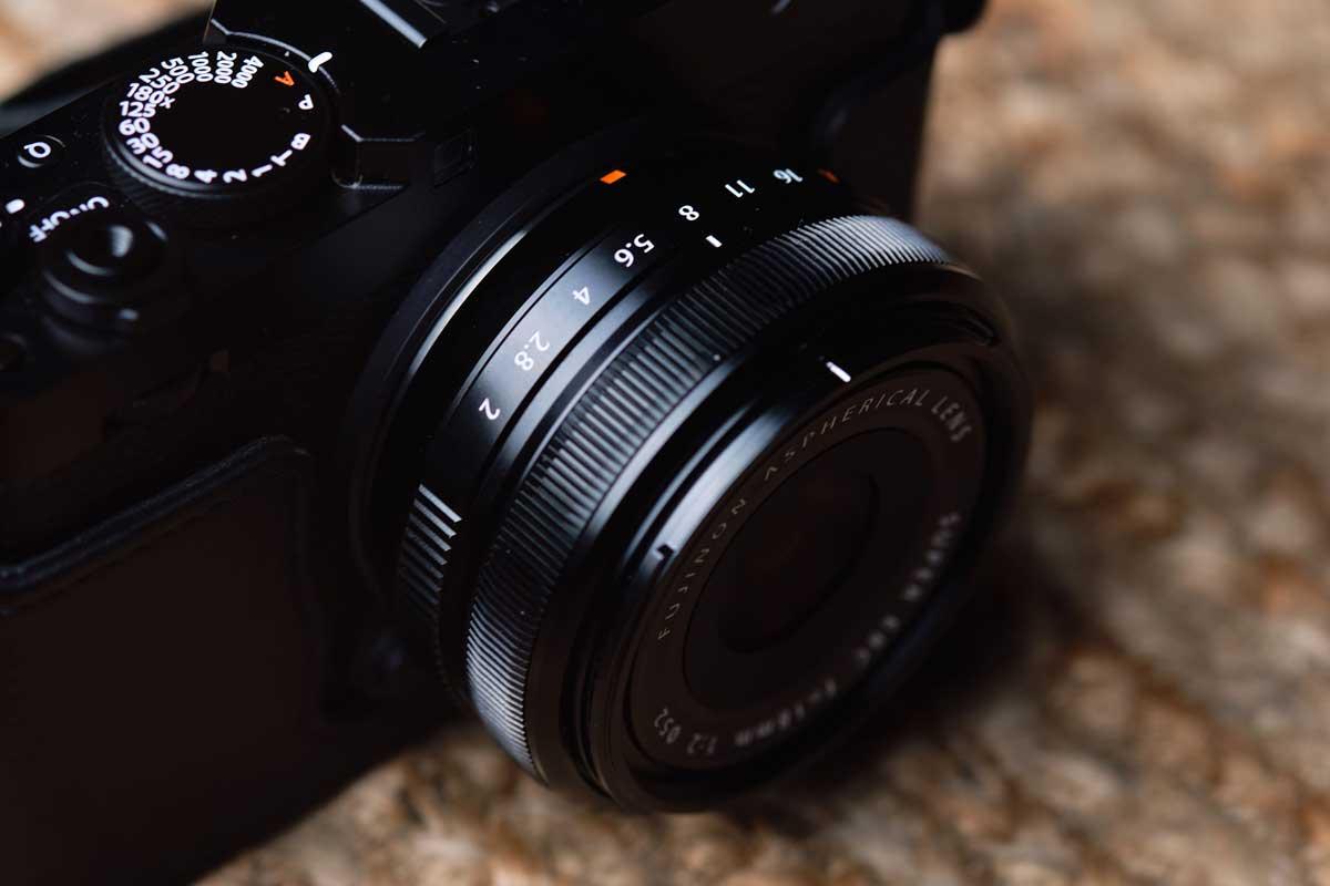 Image of the Fujifilm 18mm f/2 R on a Fujifilm rangefinder style camera